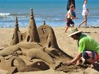 ON THE BEACH: Sandologist Steve Machell creates a stunning piece of work for the crowds that attended the Moore Park Beach Festival of Arts. Photo: Mike Knott / NewsMail