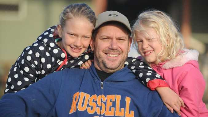 Damien Blyth celebrates Father's Day morning with his daughters Mikeeley and Georgia at the Relay for Life.