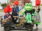 MOVING ALONG: The Memphis Moovers with a frog at the Rosewood Festival street parade on Saturday.