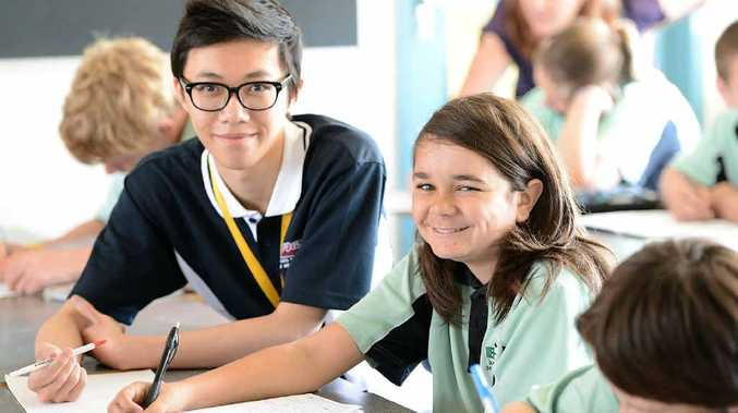 GUIDING LIGHT: UQ tutor Oscar Ho helps out Year 9 Bundamba State Secondary College student Jerome Robinson.