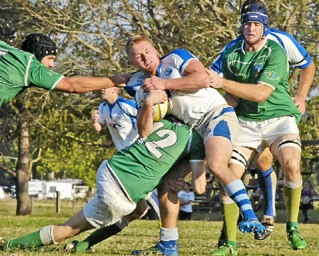 HEAVY TRAFFIC: Byron Bay's Harry Nuttall finds his way blocked by Lennox Head Trojans' backline during the minor semi-final.