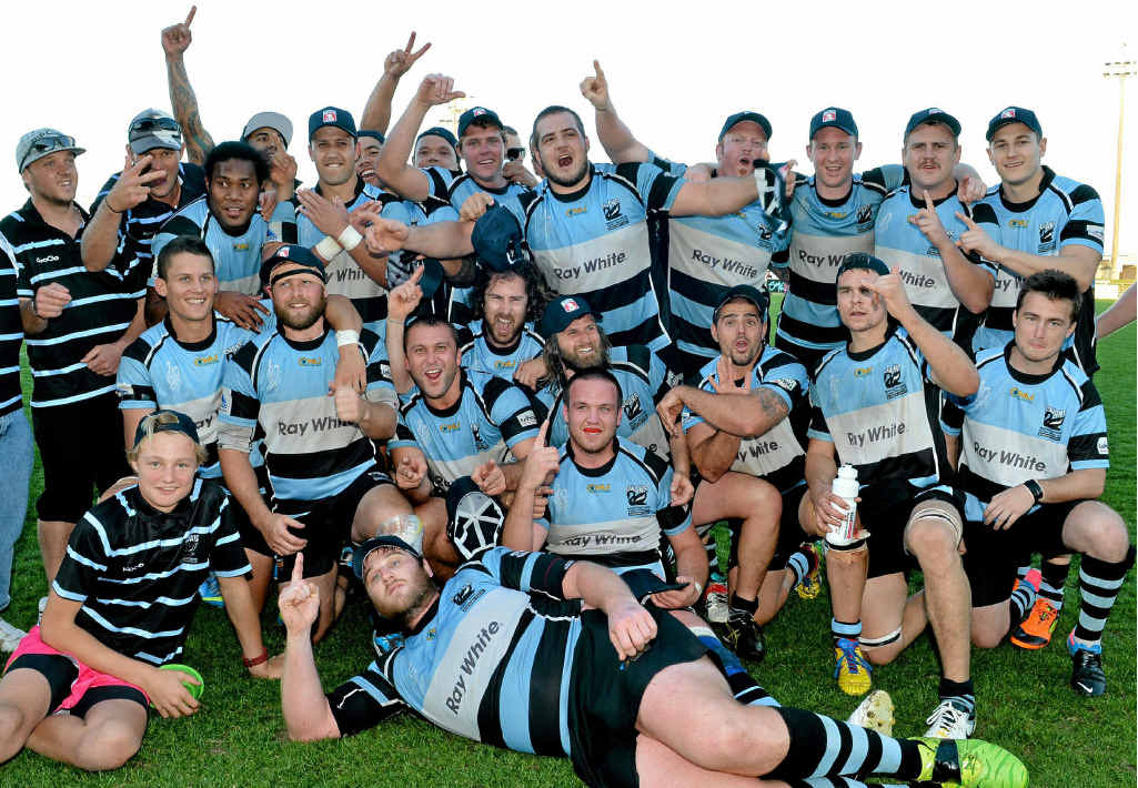 BIG NIGHT COMING UP: The Maroochydore Swans revel in the glory after beating the Noosa Dolphins in yesterday's grand final at Stockland Park.