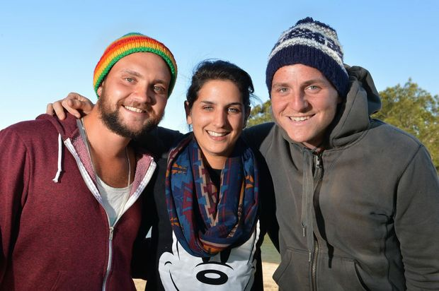 Cold weather on the Sunshine Coast. Backpacker friends (left) James Birkenshaw,24, and Jack Carter,22, from Leeds with French visitor Jennifer Coulen,22, rug up against the cold weather. Photo: Warren Lynam / Sunshine Coast Daily