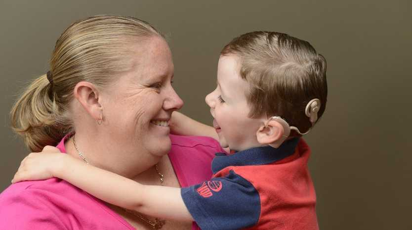 Kristy Kelly with son Riley, 3 with his cochlear implant. Photo Adam Hourigan / The Daily Examiner