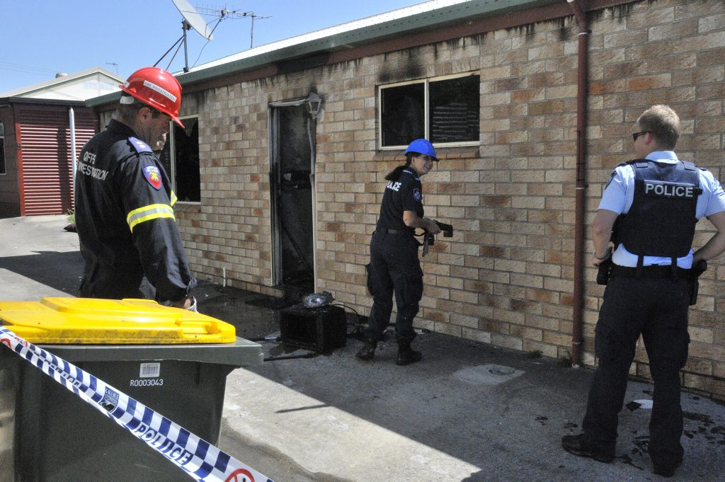 Queensland Fire and Rescue Service and Police investigate the cause of a fire at Palm Lodge single men's accommodation in Off St, Gladstone.