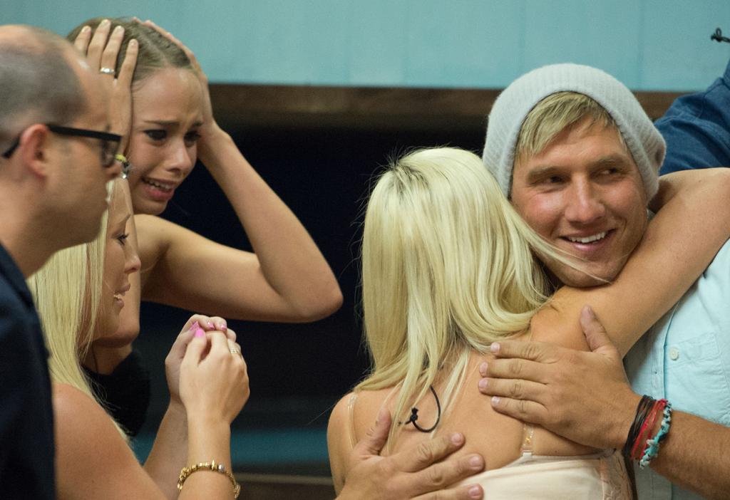 Caleb farewells his housemates.