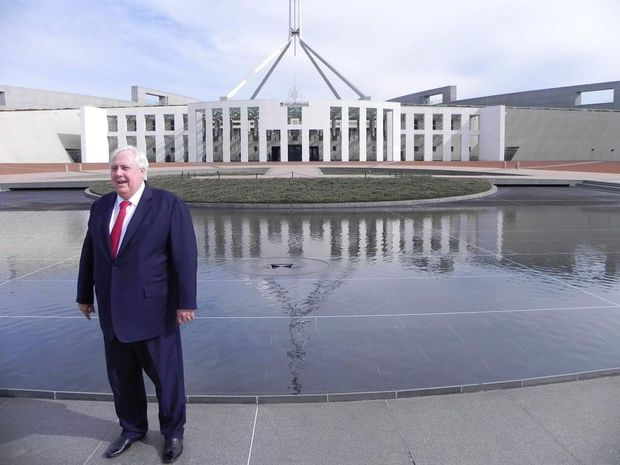 Clive Palmer on the doorstep of Parliament House