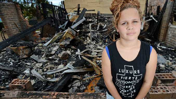GUTTED: Lani Cloos-Torrens stands in front of the remains of her Evans Head home that was destroyed by fire over the weekend.