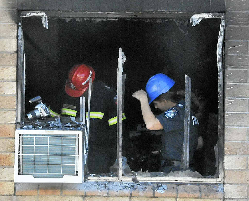 Queensland Fire and Rescue Service and Police investigate what started a fire at Palm Lodge, Gladstone.