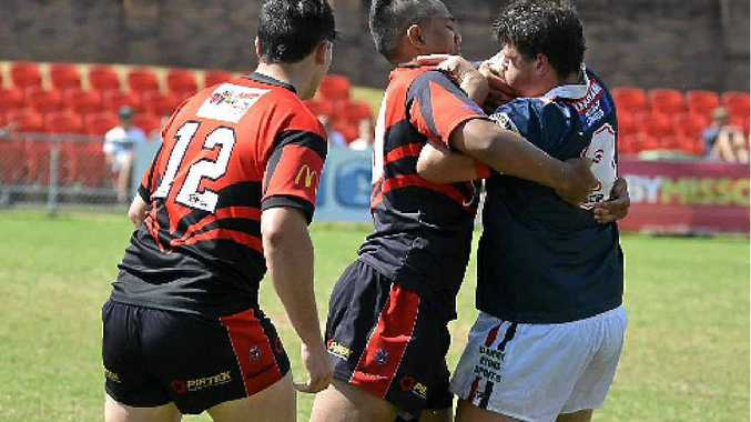 IN ACTION: Warwick Cowboys prop Mark Eastwell (right) is tackled by Valleys in a grand final loss. Man of the Match David Murphy is at left.