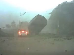 VIDEO: Lucky to be alive - huge boulder almost crushes car