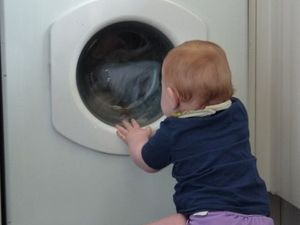 Toddler rescued after getting caught in washing machine