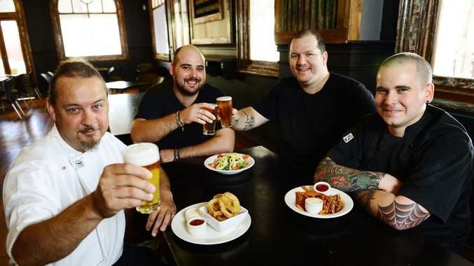 NEW FLAVOUR: (left to right) Hotel Metropole chef Bernard Green, owners Mitch Spurrier and Jason Trembath and chef Michael Barton take time out for a relaxing drink before the hotel's newly renovated Waghorn bar beer garden and diner officially opens for business.
