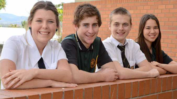 James Nash State High School Year 12 students Hannah Roff, Michael Whordley, Mitchell Beddows and Angela Bahr are all smiles after the writing task on the first day of the Queensland Core Skills Test yesterday.