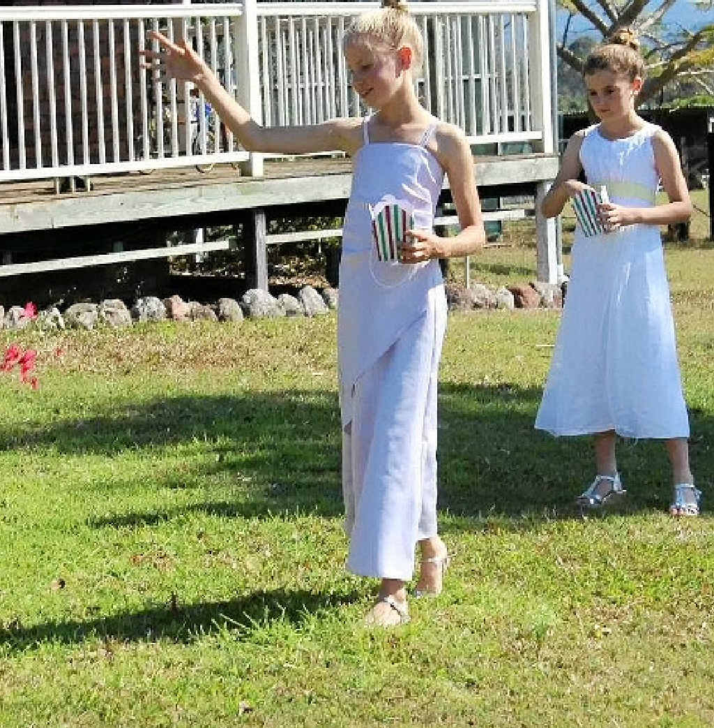 THE CEREMONY: Flowergirls Allie Salter and Lily Bromilow throw petals.