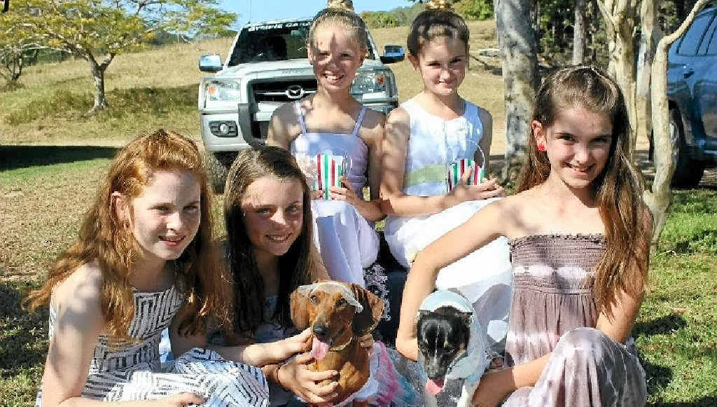 THE WEDDING PARTY: (From left) bridesmaid Ivy Dugdale, mother of the bride Lara Urwin and bride Bella, flowergirls Allie Salter and Lily Bromilow, groom Archie and bridesmaid Lillie Crumblin.