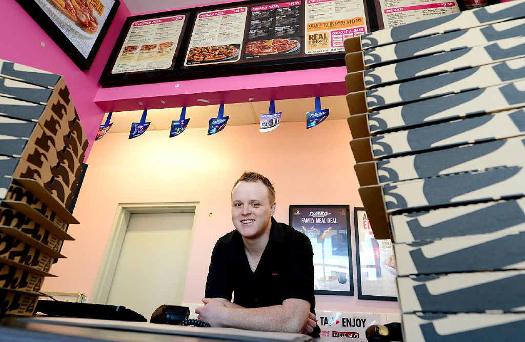 MAN IN CHARGE: Franchisee Jessee Heilbronn at his Eagle Boys North Ipswich store.