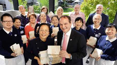 HELPING HANDS: Julia Wu (front), the principal of Tzu Chi Foundation Australia based at the Gold Coast, and other members of the Buddhist Compassion Relief Tzu Chi Foundation donate books to the Metro Hotel International and library services in Ipswich.