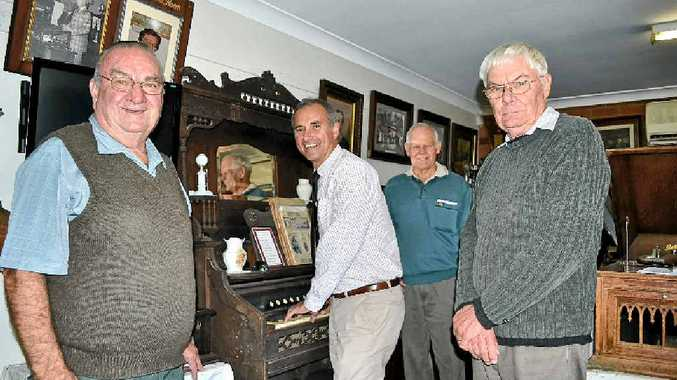 CELEBRATING WITH MUSIC: Casino and District Historical Society president Bob Moran, Clarence MP Chris Gulaptis and vice-president Barry Dennis congratulate author of Around Casino for Three Pence, John Hendley, who received a grant to publish his book.