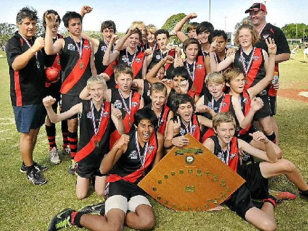 Jubilant Ballina Bombers players celebrate after claiming the Northern Rivers Junior AFL under-14 shield.