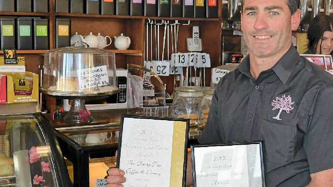WINNING SMILE: Cherry Tree Coffee & Dining owner Scott Morton with the Best New Business awards from Saturday night.