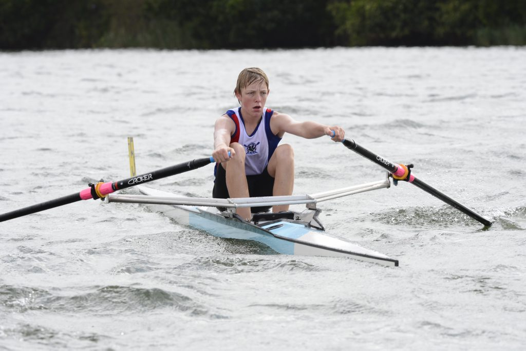 Lower Clarence rower Joshua Cormick gives his all while competing at the Lower Clarence Rowing Club Annual Regatta on the Clarence River at Maclean on Sunday. Photo Debrah Novak / The Daily Examiner