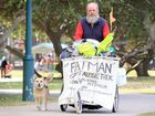 Brendon Alsop and his dog Jojo are walking about australia raising money for cancer research and treatment. They were walking through Caloundra yesterday when the Daily caught up with the pair. Photo: Brett Wortman / Sunshine Coast Daily