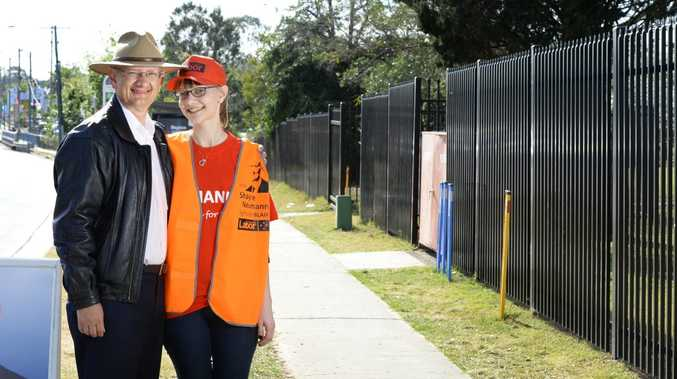 Shayne Neumann campaigning with his daughter Jacqui outside Bundamba State School on Wednesday. Photo: