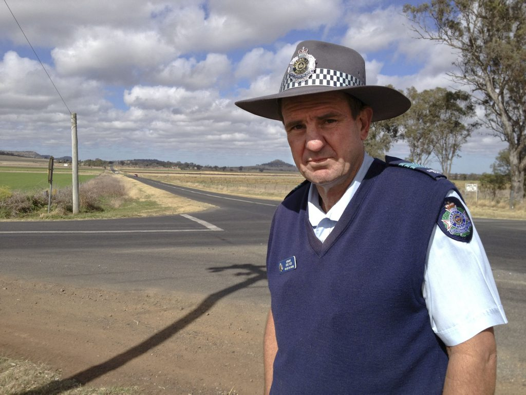 Goombungee Police officer-in-charge Sergeant Greg Kidd at the intersection of the Kingsthorpe Haden Rd and the Kelvinhaugh Yalangur Rd.