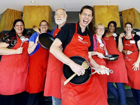 FOOD REVOLUTION: Jamie's Ministry of Food centre manager Darren Foxcroft celebrates the kitchen's 200th course with some frying pan air guitar.