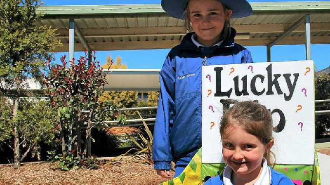 Warwick West students Bella Donn (front) and Kasey Atkins can't wait for the school fete tomorrow.