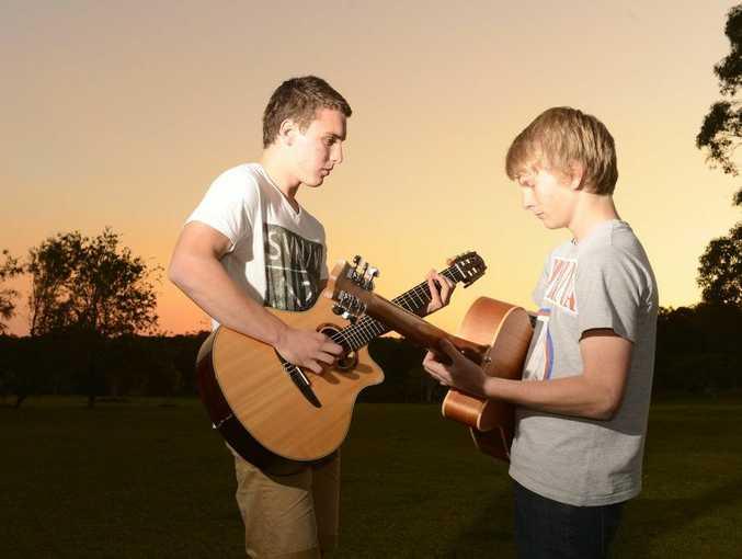 Nick Jansen and Sam Cashman - practice their flamenco style guitar duo Photo Adam Hourigan / The Daily Examiner
