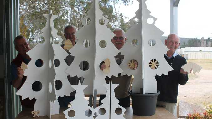 Stanthorpe Men's Shed members Paul Crowe, Alan Marsh, Neille Winter and Justin Liddy have put a lot of festive cheer into the new wooden Christmas trees they have been making.