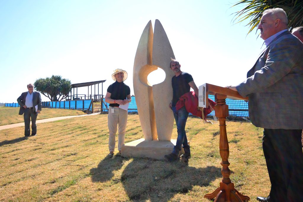 Jeramie Carter with his artworks on the Park Beach Foreshores.