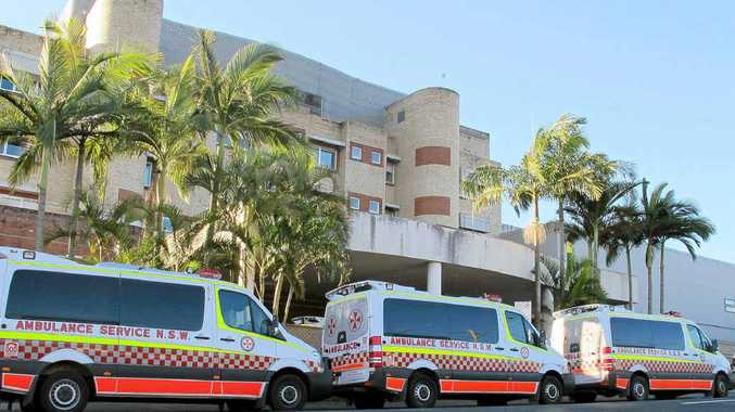 Seven ambulances queue outsdie the Lismore Base Hospital on Wednesday.