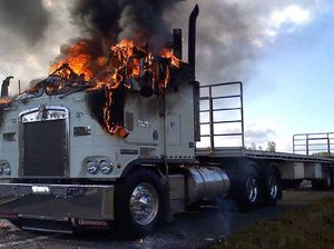 Semi driver jumps from blazing rig as flames lick legs