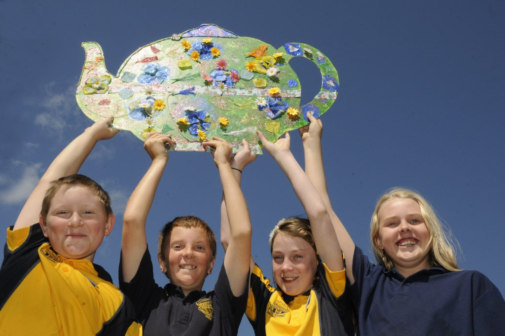 Rockville State Primary School students, from left; Adam Marshall, Hayden Palmer, Shae Tanzer and Emily Holborn with one of the teapots studetns have made for the annual carnival teapot display. Photo: Bev Lacey / The Chronicle