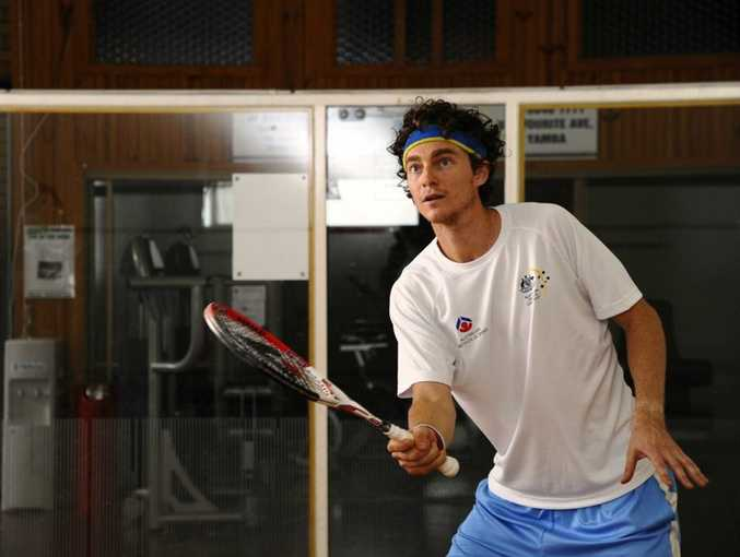 HOME TOWN HIT: Australian number one squash player Cameron Pilley has a hit at the Yamba squash courts. Photo: JoJo Newby/Daily Examiner