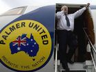 Clive Palmer yells in frustration from his aircraft toward Prime Minister Kevin Rudd's personnel in a nearby hangar after his plane was refused refuelling at Melbourne Airport.