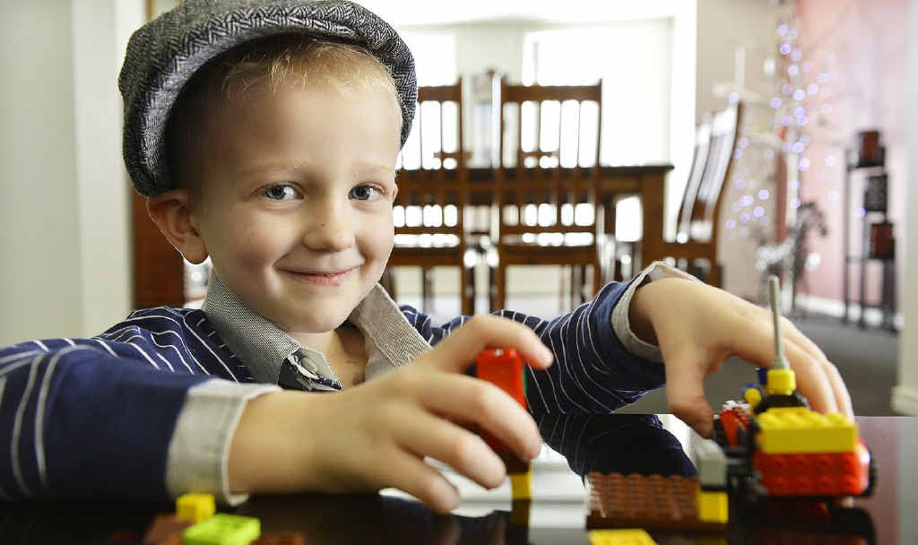 BATTLER: Kane Taylor plays with his cherished Lego set. The four-year-old was diagnosed with cancer six weeks ago.
