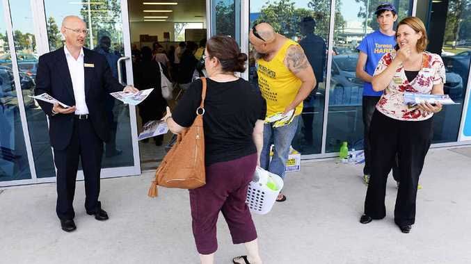 Shayne Neumann (left) and Teresa Harding (right) at the pre-polling booth at Riverlink yesterday.
