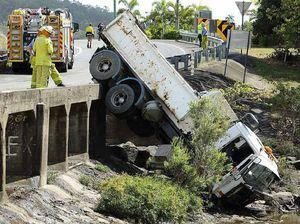 Man hurt after truck plunges off bridge