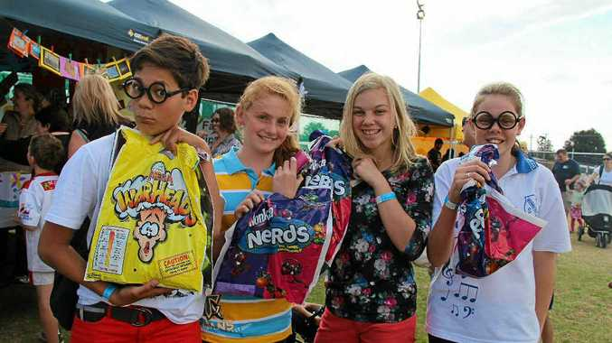 FETE FUN: Noah Kiria, Bonnie Howard, Tysharna Wright and Imogen Bilbrough were keen to tuck into their show bags at the Warwick West fete last year.