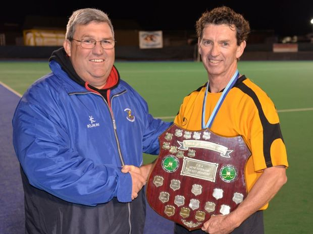 Toowoomba hockey president Steve Stewart with winning Warwick captain-coach Steve Farrell after a masters grand final victory.
