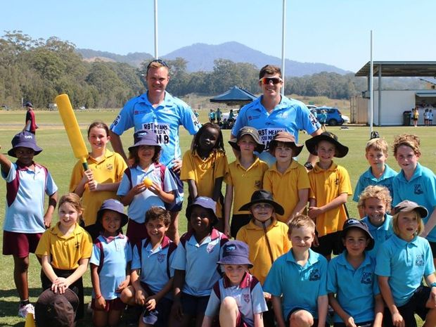 SEAN Abbott (back right) with good mate and New South Wales teammate Doug Bollinger, promoted the Toyota Country Blitz Tour to school students in Coffs Harbour last year.