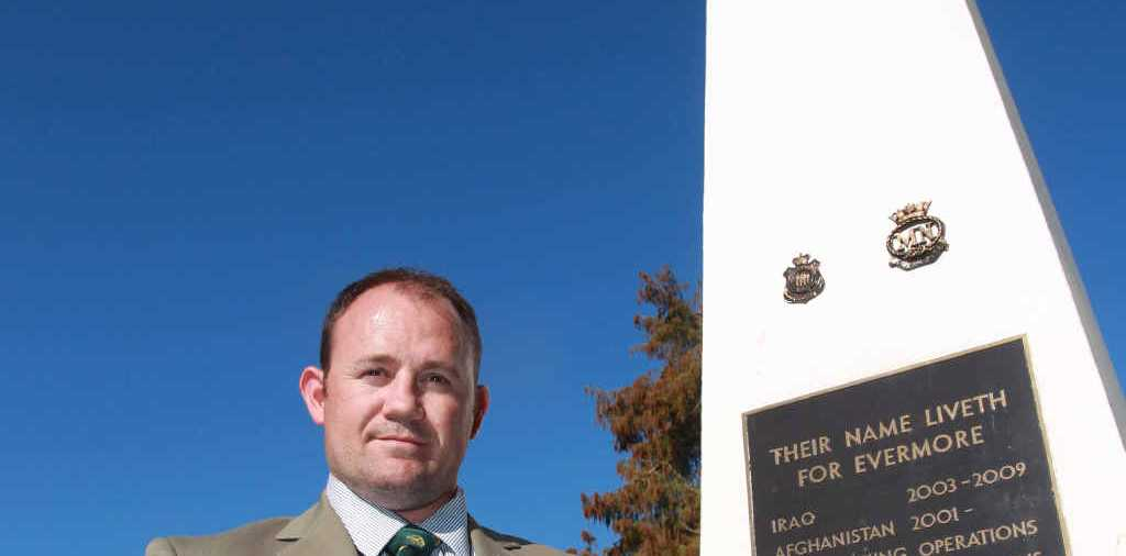 NO RESPECT: Returned Iraq and East Timor veteran, Ben Millmann, is disgusted that somebody stuck an anti-war plaque on the Nambour cenotaph.