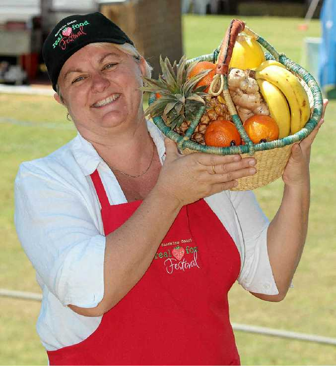 BASKET CASE: Sunshine Coast Real Food Festival director Julie Shelton proves her point about the excellence of local produce.