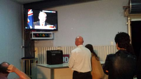 Chris Trevor watches Kevin Rudd give his concession speech on television.