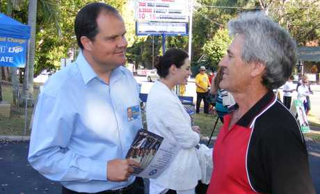 Ted O'Brien speaks with voters on polling day.