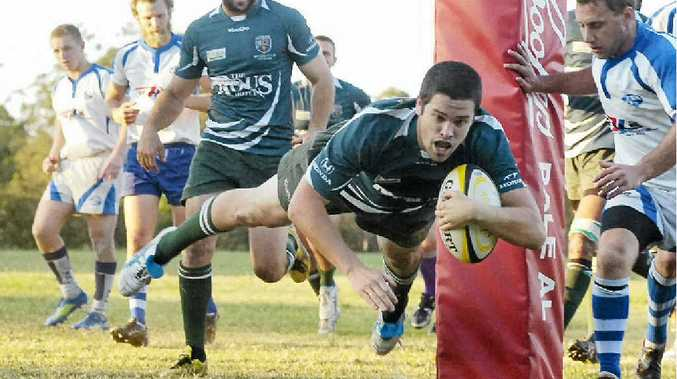 GERONIMO! Matt Bermingham crashes over the try line for his Lismore City side during the thumping victory over Byron Bay in FNC Rugby Union action.